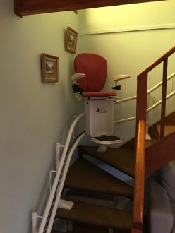 Curve stairlift with red seat